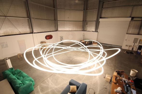 "James Clar - ""Turbulence"" (2011), industrial fan, lightbulb, wire, and micro controller, 9 m installation"