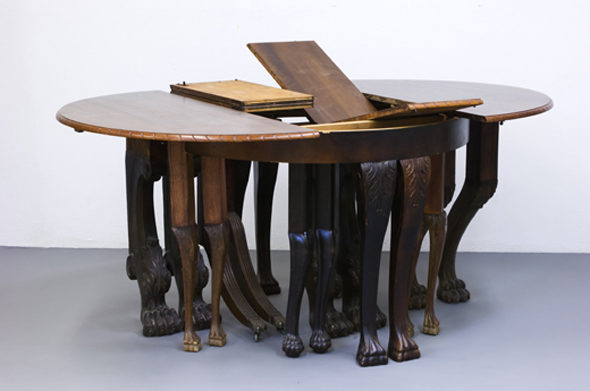 """Sonia E Barrett - """"Table Number One"""" (2012), Metal table top, antique wooden wheeled table legs, rope, sheeps intestines, styrofoam, 59 cm x 50 cm x 89cm"""