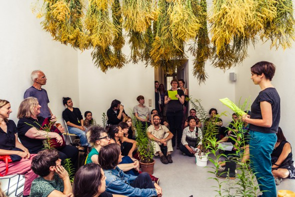"uqbar ""Living Resorts"" (2014), performative lecture by Eva Kietzmann and Petra Kübert, photo courtesy of the Project Space Festival and Paul Henschel"