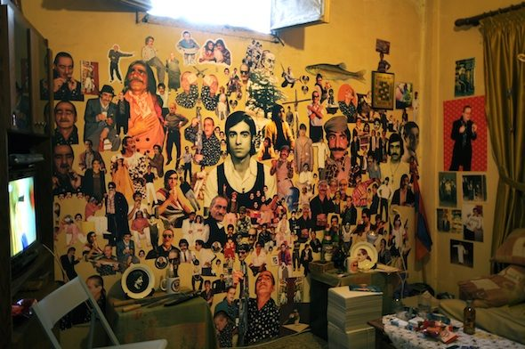 """Monira Al Qadiri - """"Anachronistic Fantastic"""" (installation), 2013. Photographs, posters, badges, and cups installed inside private apartment, with performance, 4 m x 4 m room."""