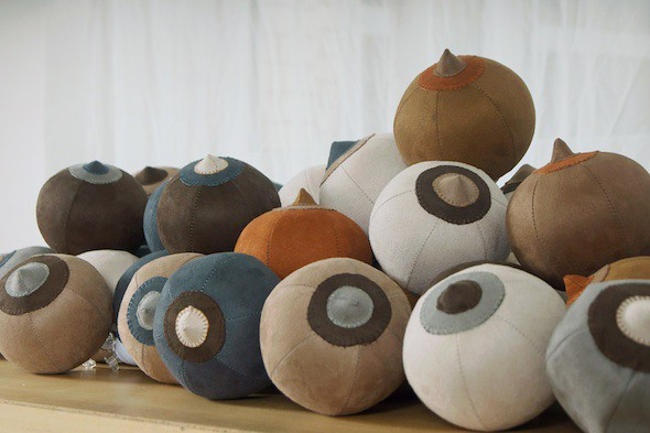 "Raquel Paiewonsky -""Bitch balls"" (mini), (2015) 100 12cm beach balls upholstered with microfiber and embroidered by hand; Courtesy of the artist"
