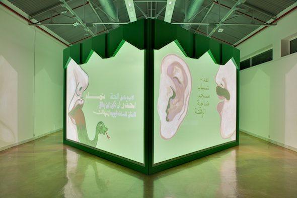 "Monira Al Qadiri - ""Muhawwil"" (Transformer), 2014. 4-channel video installation with wooden structure. 4 x 3 x 4 m"