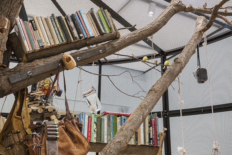 Mark Dion: 'The Library for the Birds of New York/The Library for the Birds of Massachusetts' (detail), 2016/2017. Steel, wood, books, living birds, and found objects, 138 × 240 inches (350.5 × 609.6 cm). // Courtesy of the artist and Sammlung Migros Museum für Gegenwartskunst, Zurich. Photo by John Kennard.