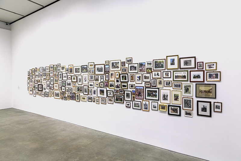 Mark Dion: 'Men and Game', 1998. Framed photographs in various media, 120 parts, dimensions variable. // Courtesy of the artist and Galerie für Landschaftskunst Hamburg, Hamburg. Photo by John Kennard.