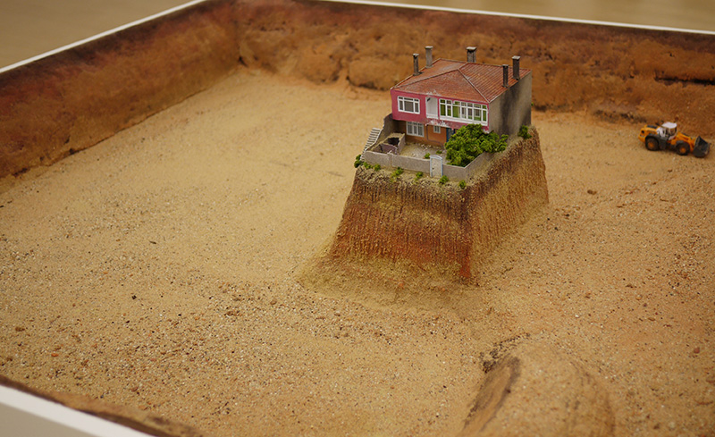 A model of a 'Nail House', sculpture by Turkish artist Ahmet Ogut