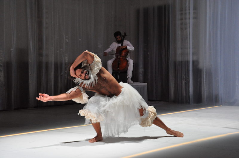 Two Black performers dancing on stage at Ballhaus Naunynstrasse in white costumes
