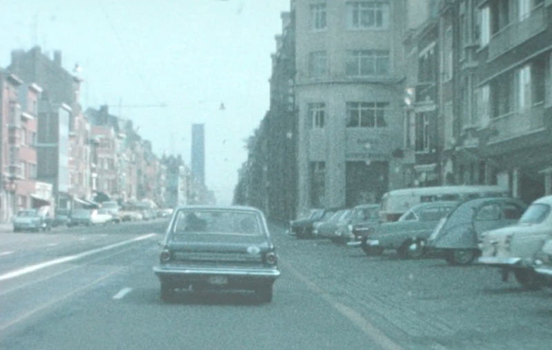 Berlin Art Link Interview with Sandra Heremans. Archival film still of a car driving down a city street in Belgium from the 1960s