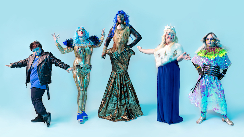 All the members of Drag Syndrome are posing in the stage wearing different costumes.