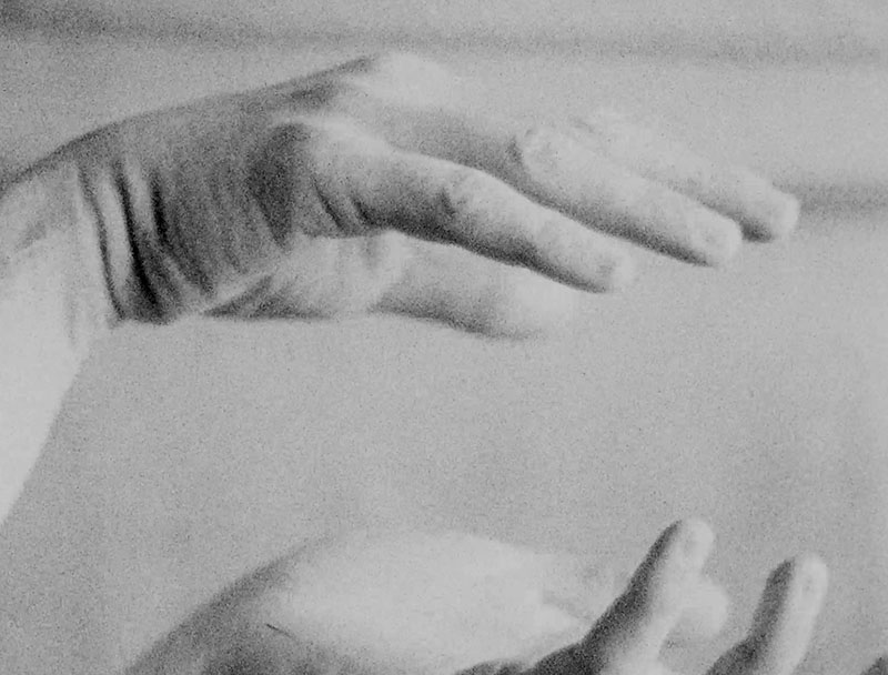 a black and white photograph of a close-up of Wendy Carlos' hands cupping the air.