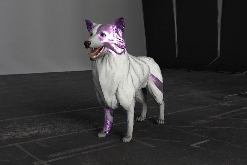 A photograph of a sculpture of a white dog with a metallic purple face and metallic purple stripes.