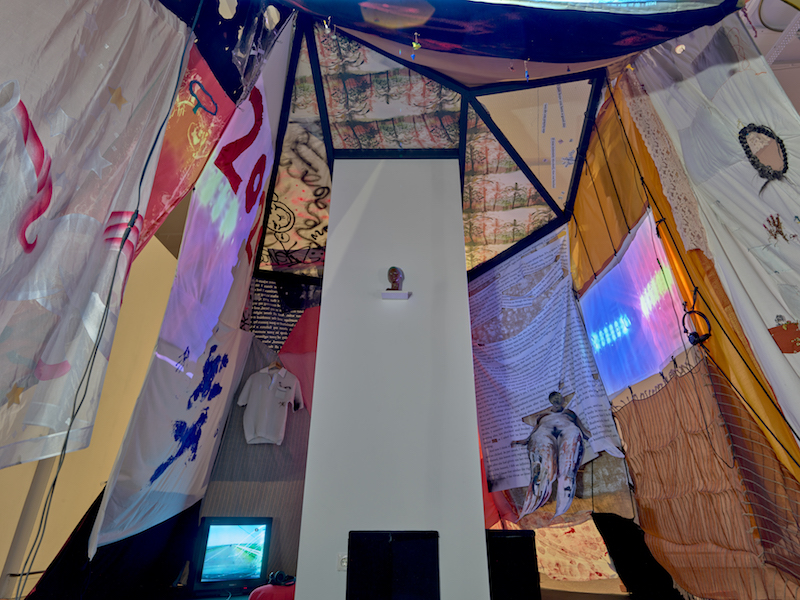 The inside of the blanket fort with a view of a TV