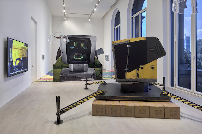 two large-scale sculptures made from cardboard and metal in a gallery space