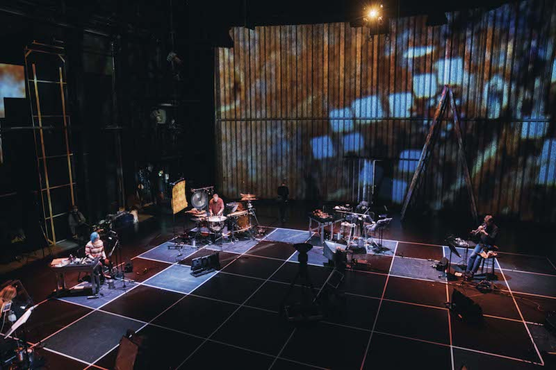 a stage is set up for a concert with multiple recording devices and instruments standing set out