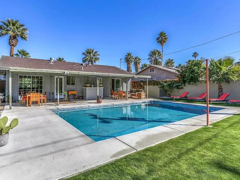 a photo of a swimming pool in the backyard of the bungalow in palm springs, california