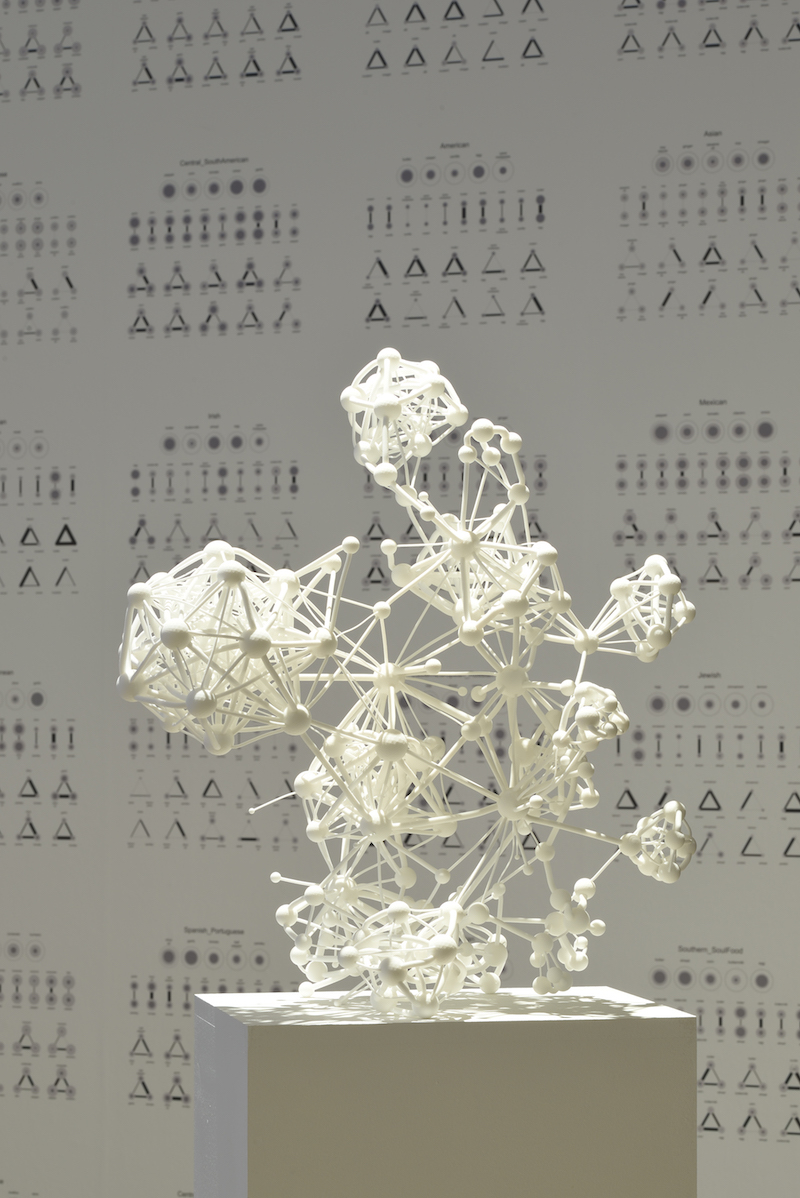 a white 3d sculpture of visualized data in the form of small clusters attached to nodes, standing on a pedestal