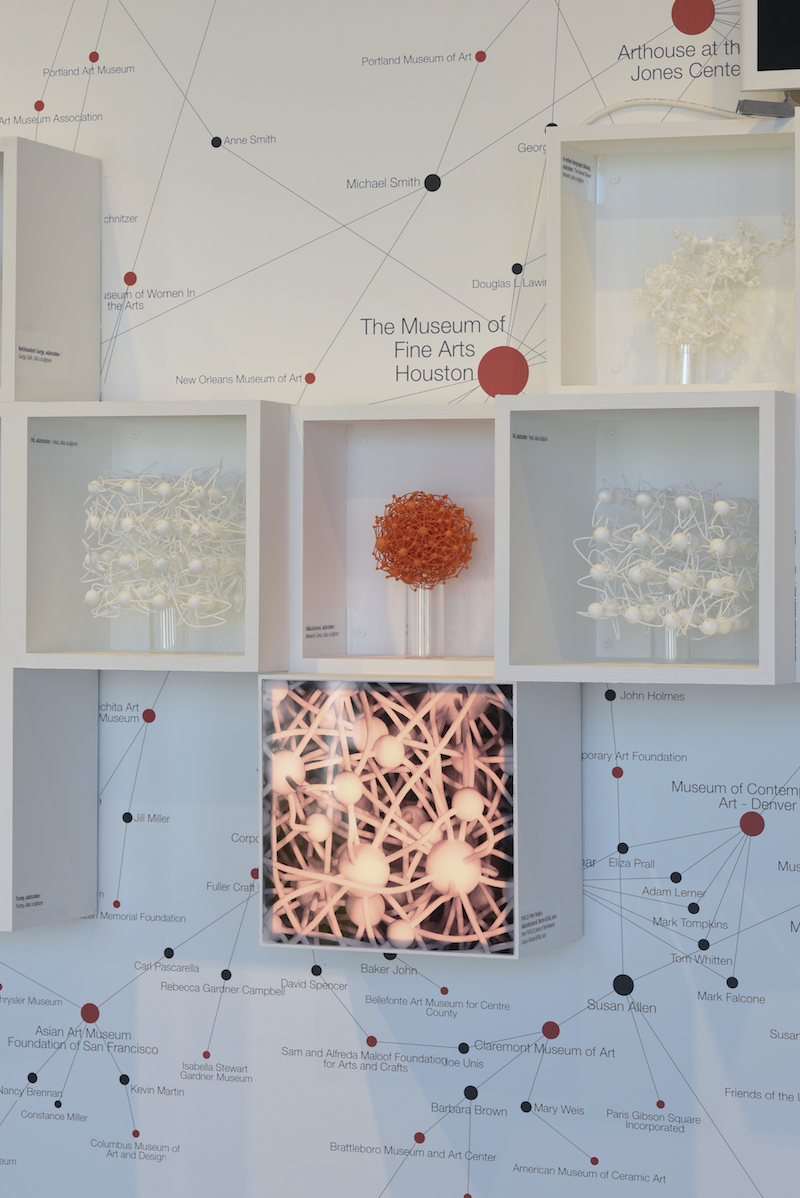 four white frames containing various sculptural data visualizations and images