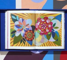 a spread from inside Beatriz Milhazes monograph, showing a graphic, colorful print of flowers
