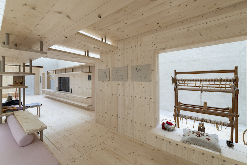 a weaving / craft area set into the wooden constructed installation