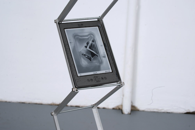 an e book reader mounted on a metal structure like a sculpture