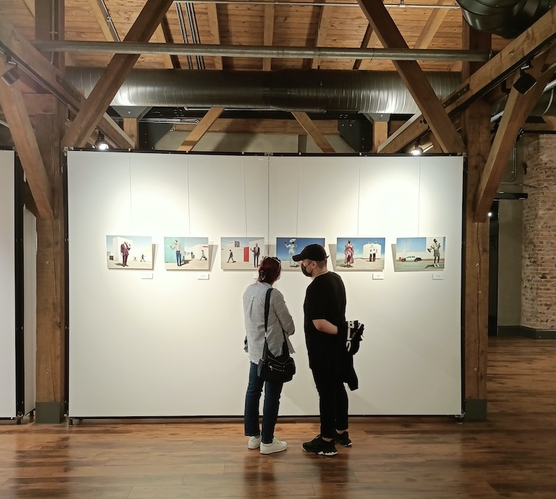 two people looking at photography in gallery